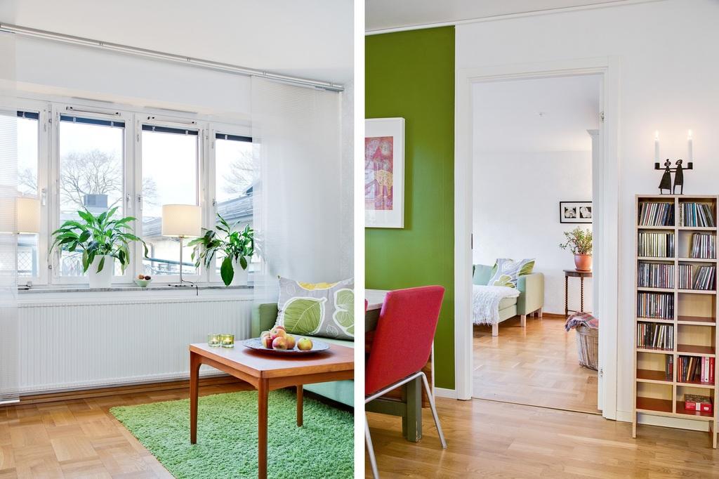 Vardagsrum och del av kök in mot vardagsrummet
