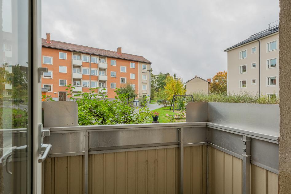 Balkongen vänd mot grönska